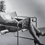 Erich Consemüller, Woman in B3 club chair by Marcel Breuer wearing a mask by Oskar Schlemmer, ca. 1926 black-and-white photograph Photo © Stefan Consemüller / Bauhaus-Archive Berlin